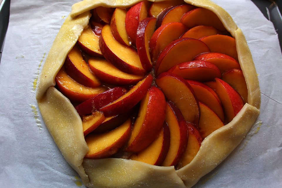 Unbaked peach brown butter almond galette | Nomad with Cookies
